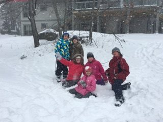Students playing in snow.